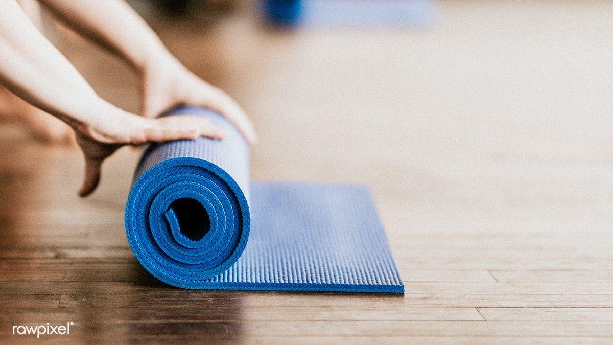 Download Premium Image Of Yogi Rolling Her Blue Yoga Mat 1225136 Yoga Mats Best Yoga Mat Yoga