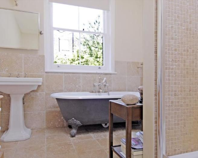 Bathroom Tiles Traditional photo of traditional beige cream pastel pink white bathroom with