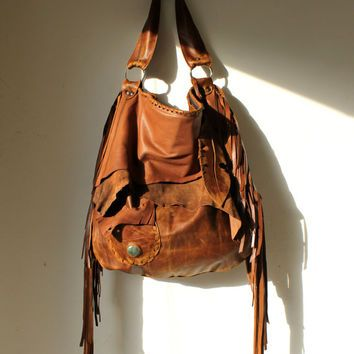 Large tribal rusted  leather raw edges gypset rusted chestnut brown distressed  fringed bag fringe raw tote  autumn fall hobo tribal