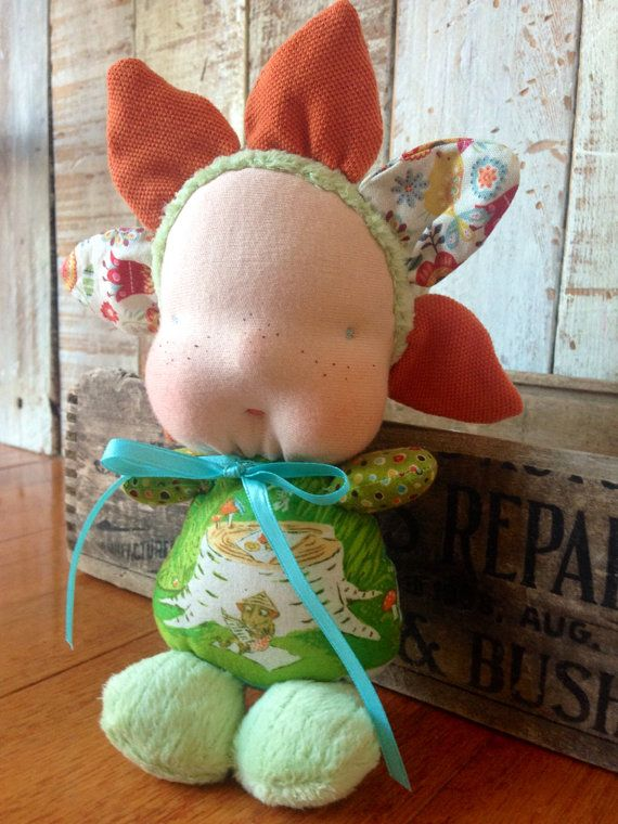 "Waldorf inspired ""blossom baby"" flower doll  By: A Curious Twirl"