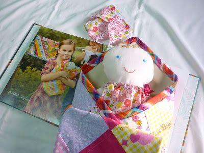 "swaddled baby love. pattern taken from book ""handmade begginings"""