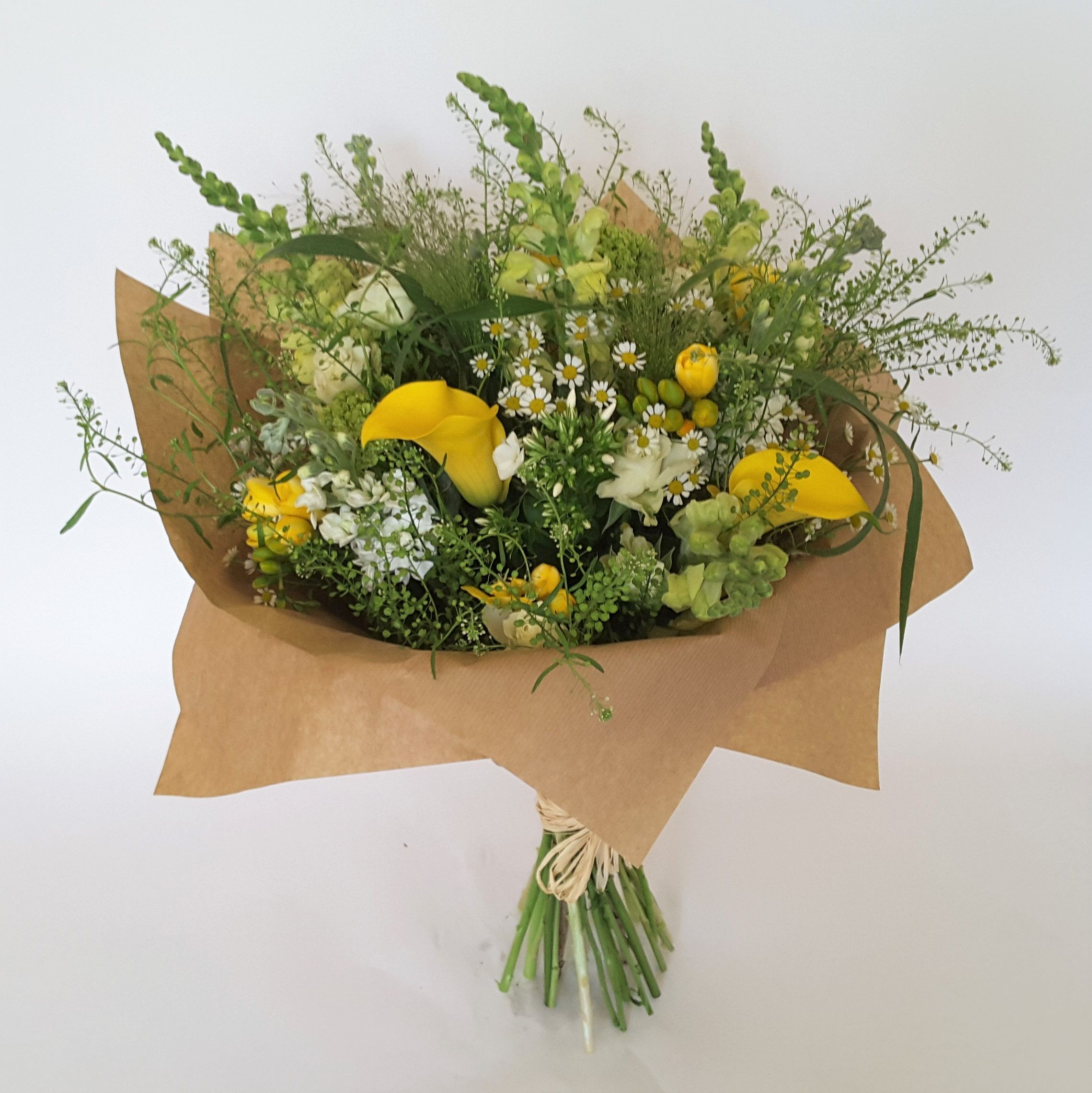 A stunning handtied bouquet in white and yellow flowers