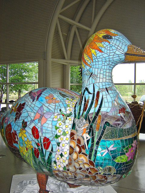 This is a huge goose on permanent display at the Indiana Welcome Center, located at I-80/94 & Kennedy Ave. South   Hammond, Indiana   the goose is covered in beautiful stained glass mosaic. Unfortunately, even though I called the center, the artist(s) are unknown.  If anyone knows please tell me and I will credit their name here.  This is a lovely work of public art and stands around 5 feet by 6 feet wide.