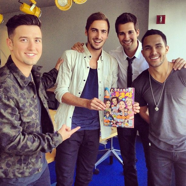 Big Time Rush posing with a magazine. I see some of my favorite stars in that magazine :)