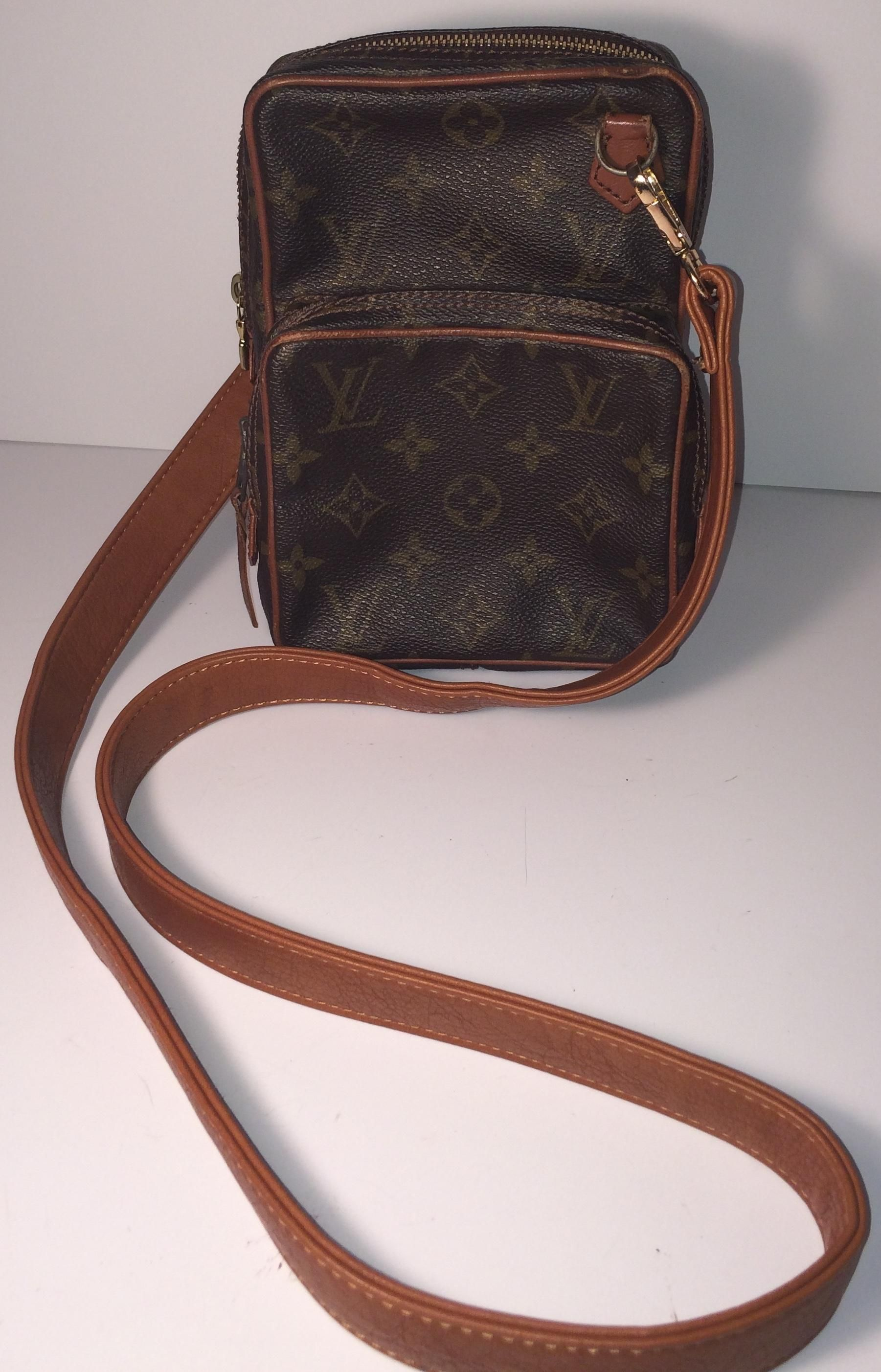 61a855cbfa6d Louis Vuitton Mini Amazon 862 With Leather Strap And Lv Charm Brown  Monogram Cross Body Bag. Get the trendiest Cross Body Bag of the season!