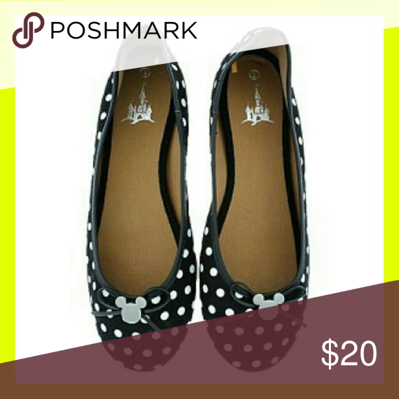 Disney Polka dot Flats Used once while in Disneyland, in perfect condition. Size 6.5, very comfortable and fun to wear.  Disney's polka dot ballet flats feature a silver tone Mickey icon with a black simulated leather bow on top of the toe.   Black with white polka dots Silver tone Mickey Icon Disney Shoes Flats & Loafers