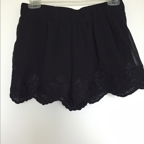 Black shorts with scalloped edge Black dress shorts with scalloped edge. Very good condition Urban Outfitters Shorts