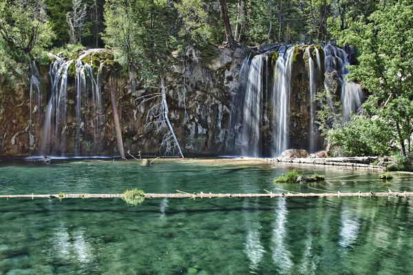 Hanging Lake is a crystal-clear, turquoise blue lake that is a short, steep, but rewarding hike that starts in Glenwood Canyon, near Glenwood springs, Colorado