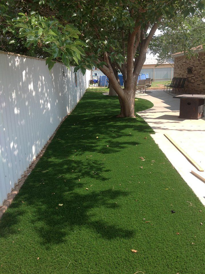 Back yard in Post, Texas. Artificial turf installed by Golf Greens Texas.com