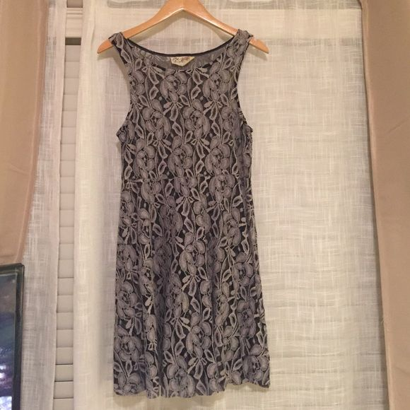 Free People Grey lace dress Size Small. Grey and black lace dress. Will need a slip to wear under. The dress is a little bit above the knee and I'm 5'3 Free People Dresses