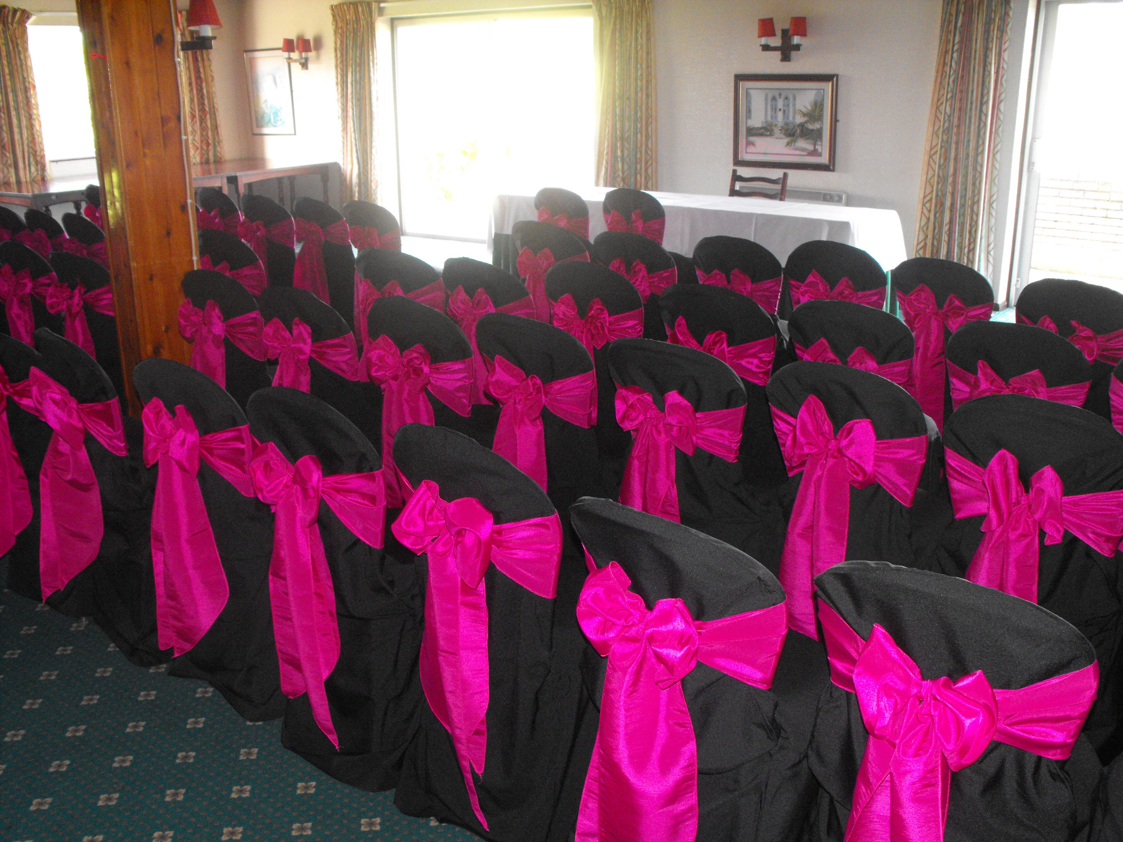 Black Chair Covers With Fuschia Pink Satin Bows Black Chair