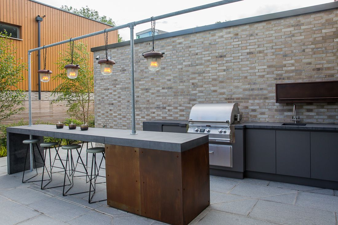 outside bar/kitchen - bespoke joinery concrete, corten steel details ...