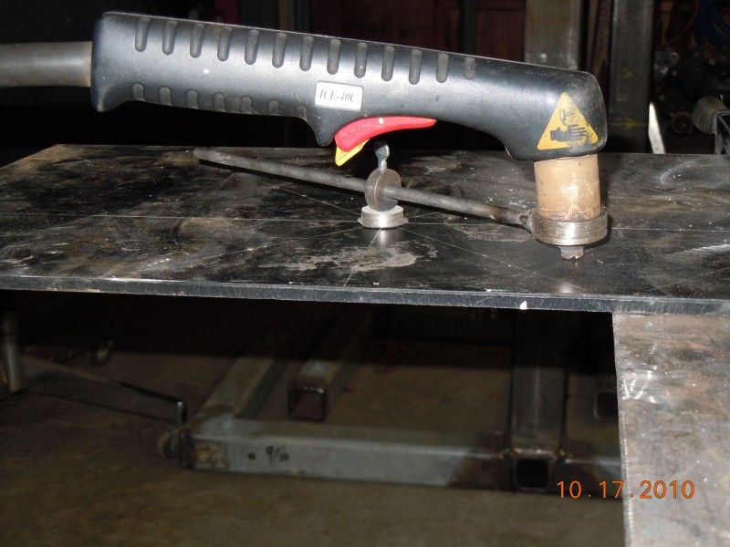 Homemade plasma cutter constructed from surplus automotive and appliance components.