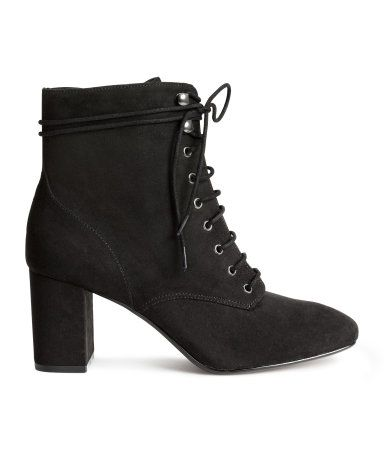 Black. Lace-up boots in imitation suede with a zip at side and covered heels. Satin lining, imitation leather insoles, and rubber soles. Heel height 3 in.
