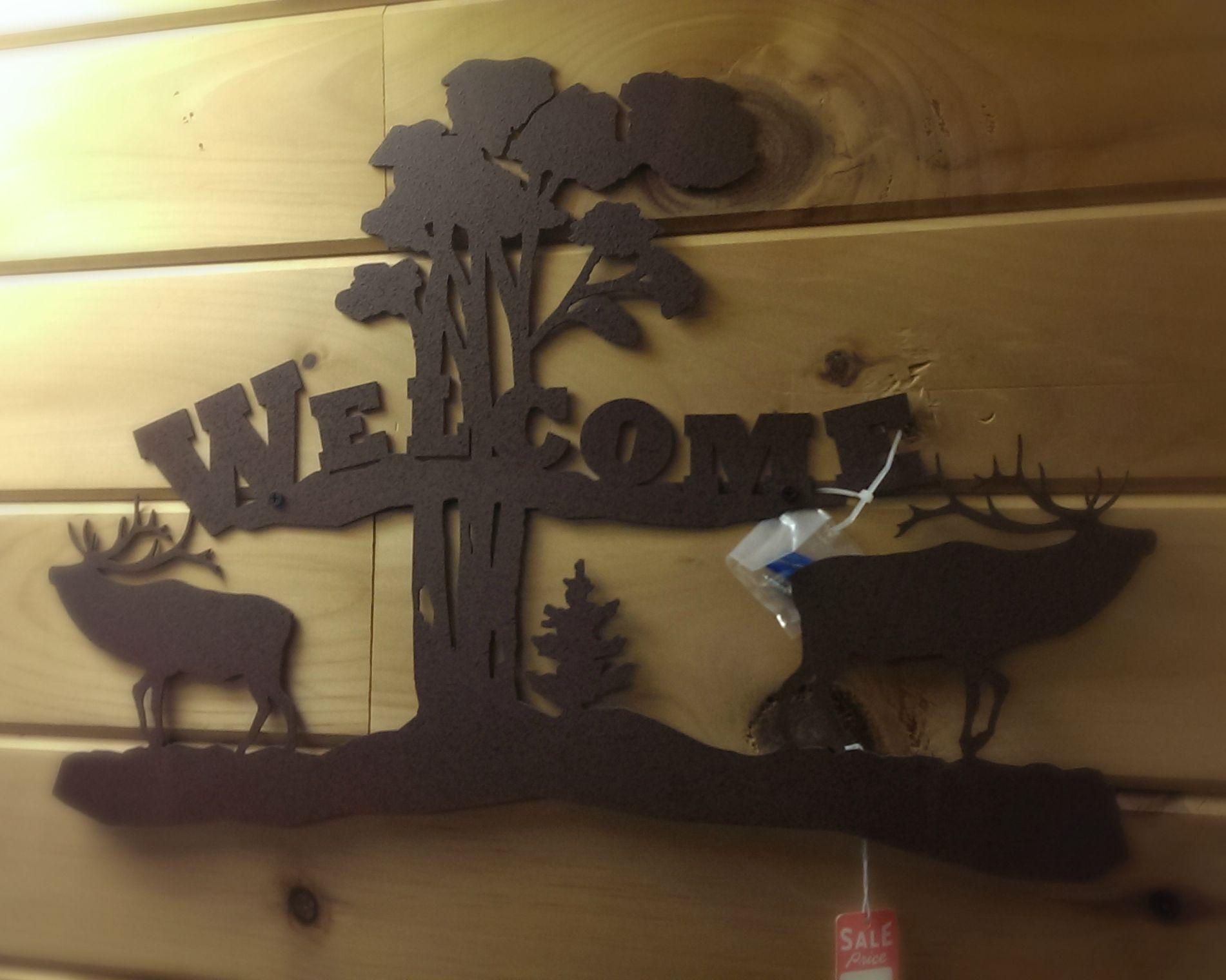 Welcome visitors with this iron elk welcome sign!