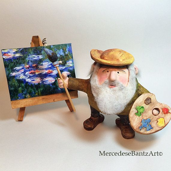 Original, one of a kind Claude Monet character figurine. Monet is sculpted using white polymer clay over a glass ball. After sculpting he was baked in a toaster oven. All of the details were then carefully hand painted with oil paint. His paintbrush is made of polymer clay too and has a wooden stick handle. His palette is also sculpted from polymer clay. The water lilies type painting is on a small canvas. It was hand painted by me in acrylic paint. Ive stained the little wooden easel that…