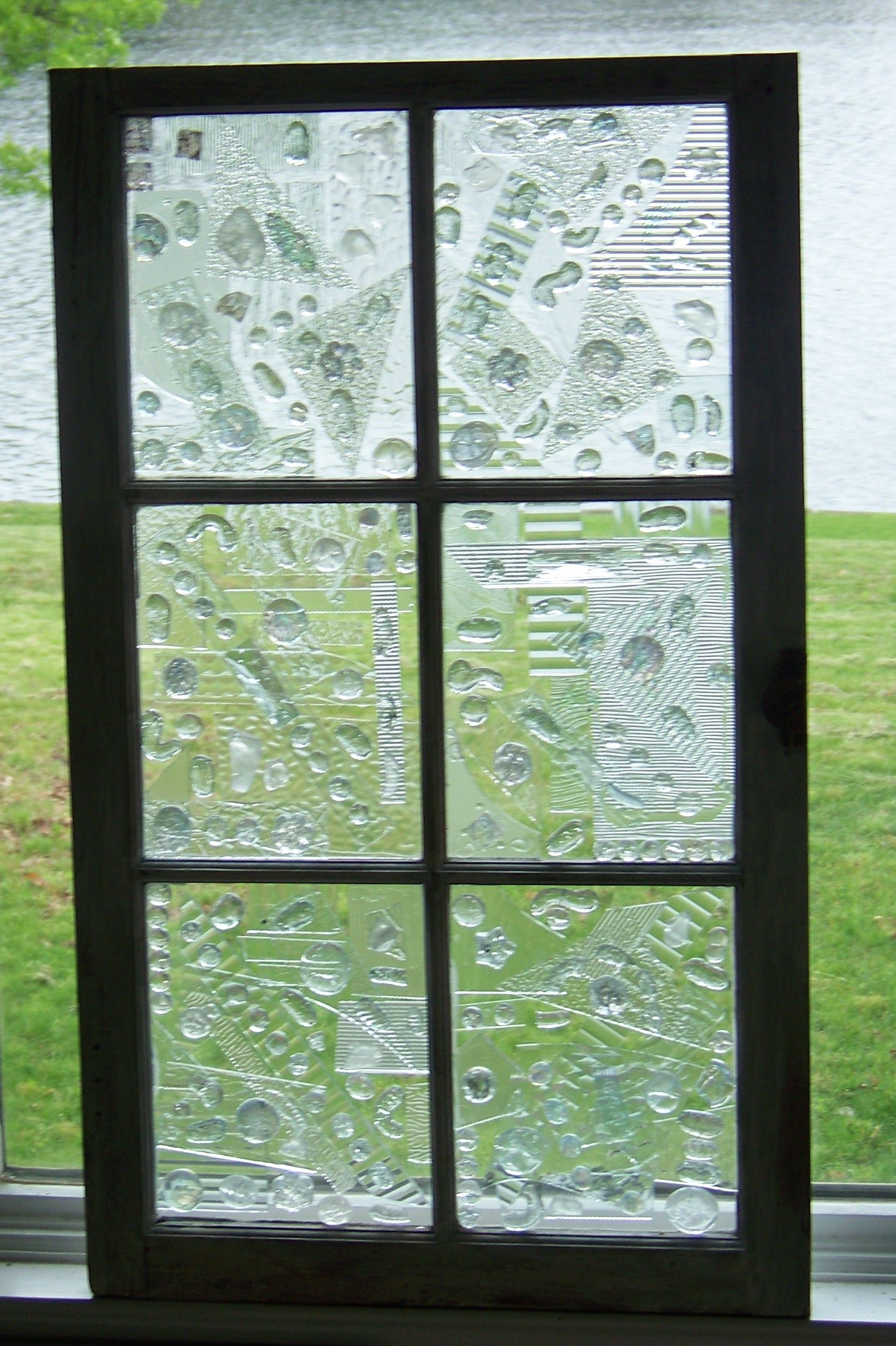 Old window decorated with broken glass.  Glass window art, Glass