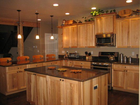 dark kitchen cabinets with light granite countertops what granite choice with hickory cabinets 14474