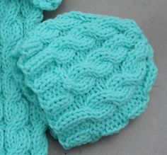 FREE - 12-15 inch cabled baby hat More 7b0e9996510