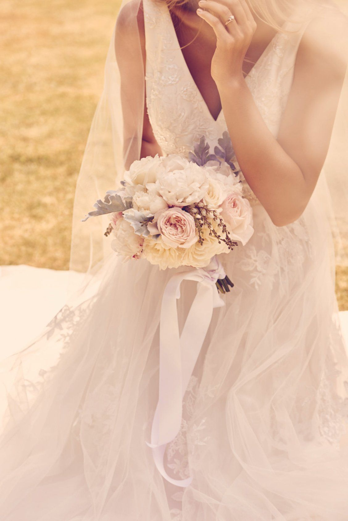 A Bright White And Pastel Bridal Bouquet That Looks Lovely Against