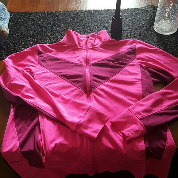NIKE TRACK JACKET DRI FIT Woman's pink NIKE dri fit track jacket. Only wore one time. Sz. Large. Nike Other