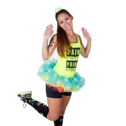 ON SALE!! Orignal $30.00 Our LED light-up rainbow tutu is great for those night races and doubles as a Halloween costume. It measures 8 inches long and works perfectly with capris, bike shorts, running shorts and even running skirts. Shown paired with our Pain and Pride Tech Tank in Yellow. See our Accessories Category and add a tiara and knee socks to complete your bright new look.  Tutus are great for all running events including color runs, Diva and Disney-themed races. Add some fun to…