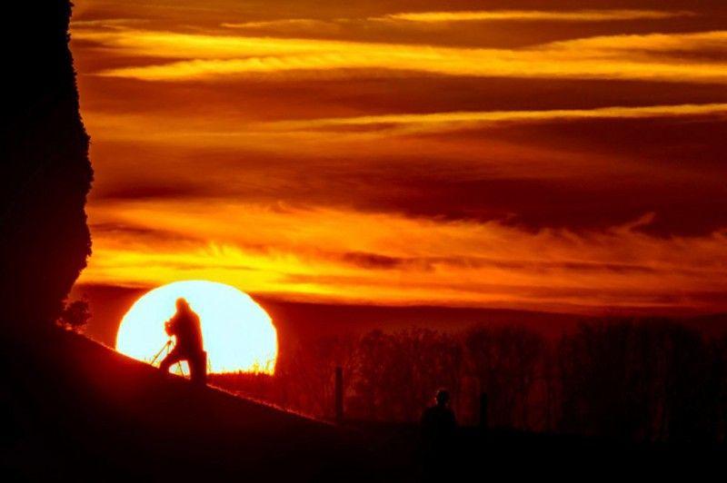 Un fotógrafo tapando el sol - ALTFoto