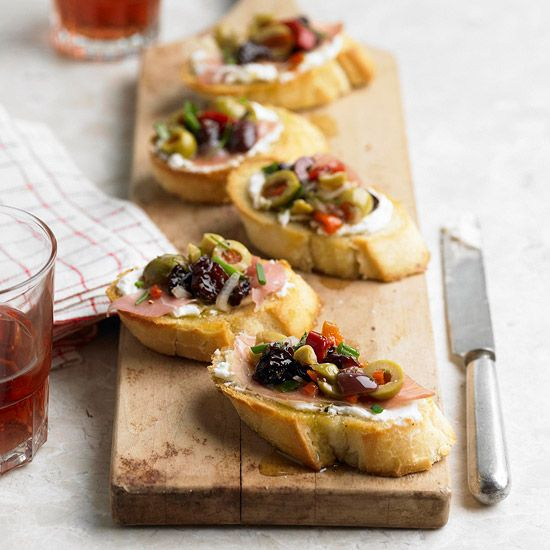A wonderful blend of Mediterranean flavours call this Olive-Cherry, Goat Cheese, and Prosciutto Bruschetta home. #Italian #appetizers #bread #food #snacks #party #bruschetta