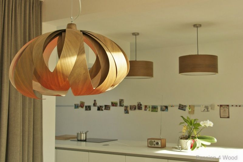 Tulip and Ring lights in walnut wood in a kitchen, all lights are designed & made by Passion 4 Wood