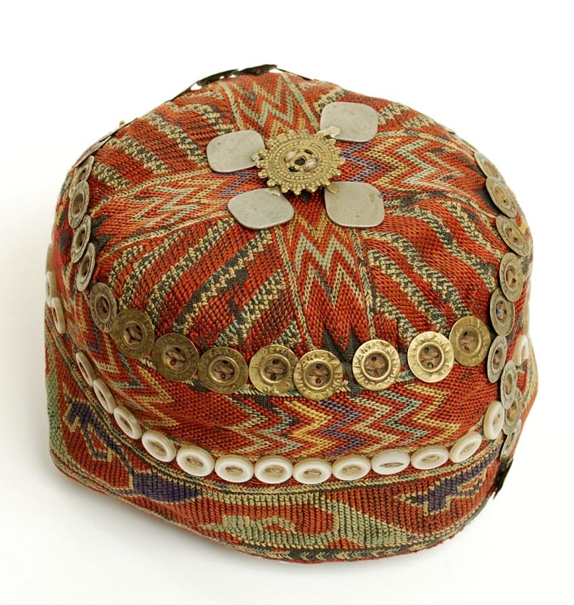 49ba495a398 A vintage Pashtun tribal hat from the Swat valley in Pakistan s northern  area. Hand embroidered cotton with buttons and bronze ornamentation.