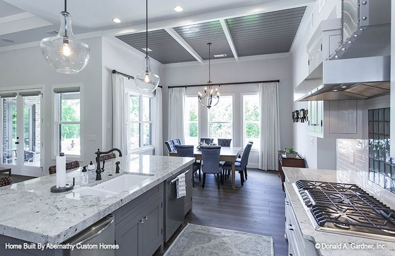 Gourmet kitchen with a massive center island! A modern version of