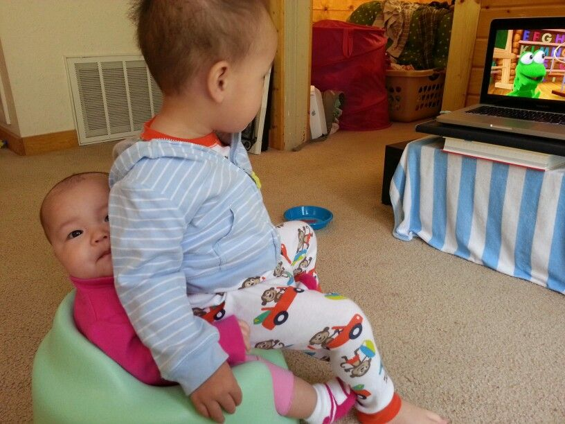 Big brother babysitting his sister
