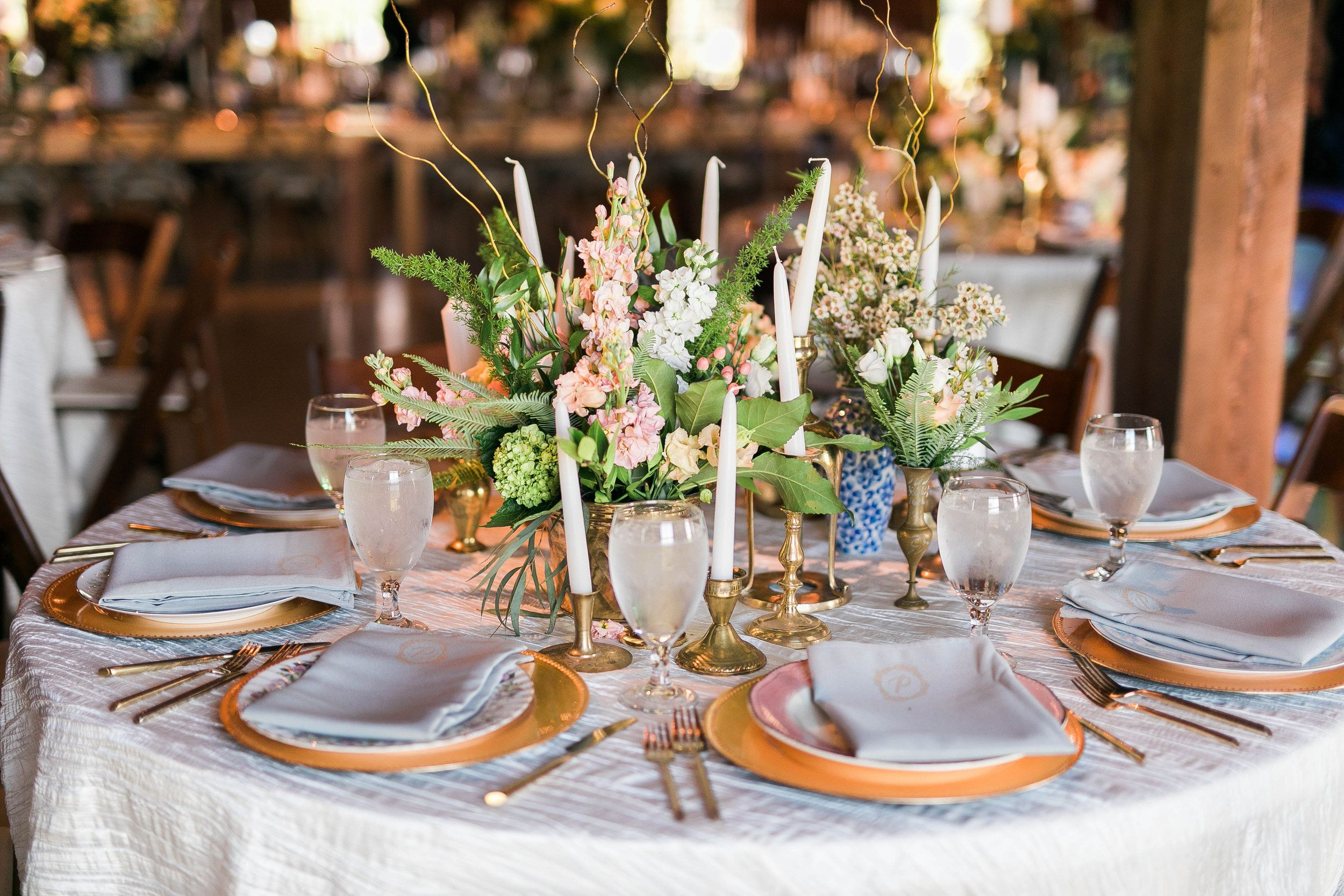 Reception With Settee Table Numbers Brass Candles Mismatched China Romantic Barn Wedding By Rent My Dust Bough Vintage Rentals Barn Wedding Flower Cart