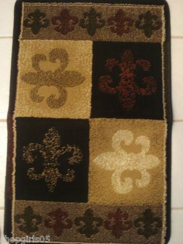 """NEW! THIS FLEUR DE LIS RUG WOULD MAKE ANYROOM IN YOUR HOME BEAUTIFUL!! STUNNING COLORS, BLACK, GOLD, OLIVE, BURGANDY AND WHITE. MEASURES APPROX. 23"""" WIDE BY 36"""" LONG."""