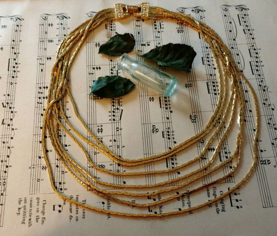 Check out this item in my Etsy shop https://www.etsy.com/listing/485853100/retro-1990s-gold-waterfall-necklace-by