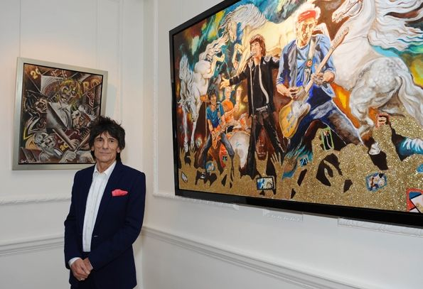Ronnie Wood poses near his new collection of fine art, 'Ronnie Wood: Raw Instinct' at Castle Fine Art in London.