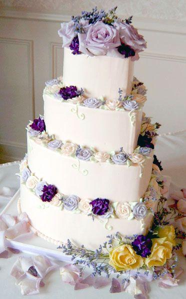 Heart shaped wedding cake with purple flowers weddingcake