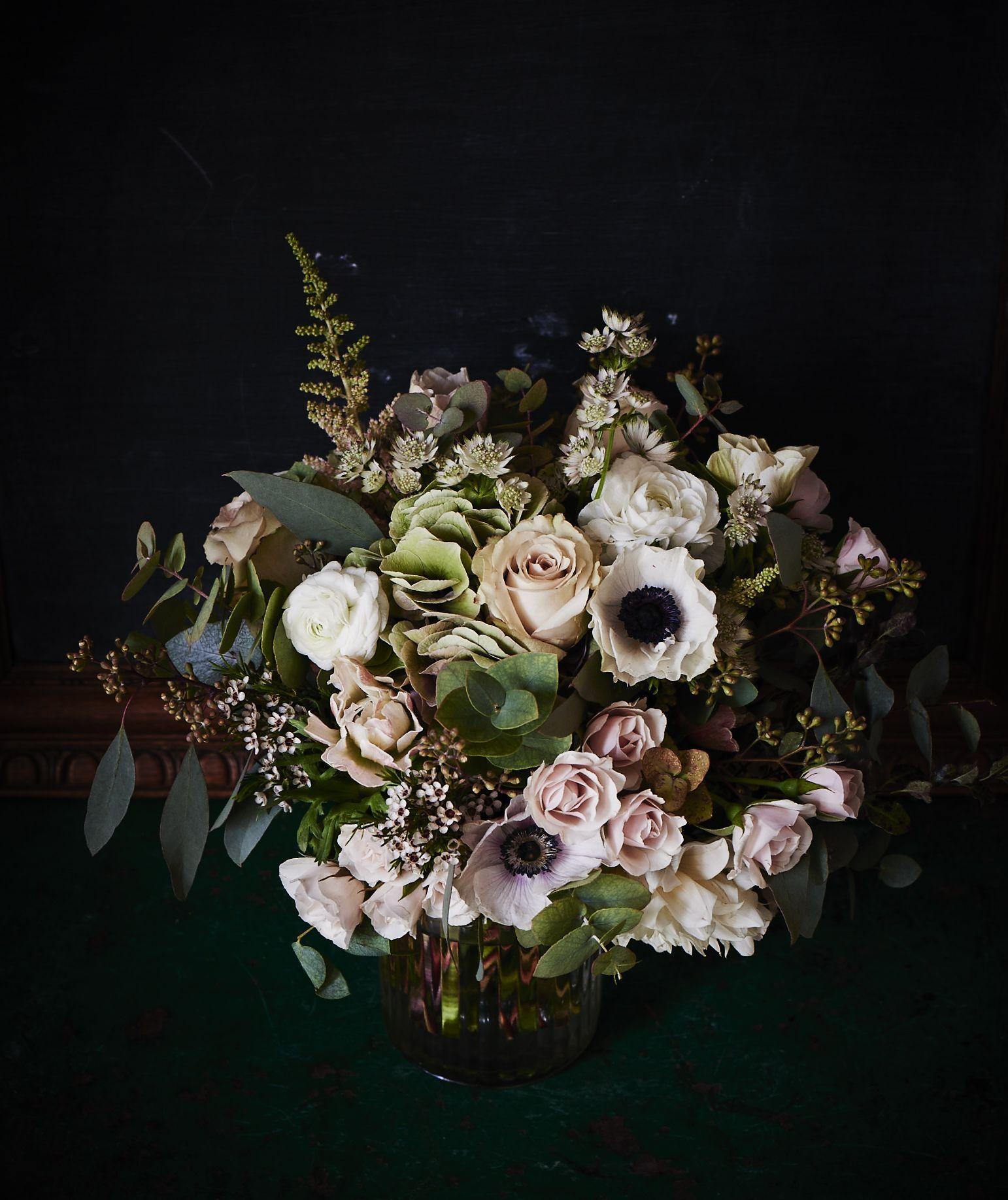 flowers on black background Flower arrangements, Flower