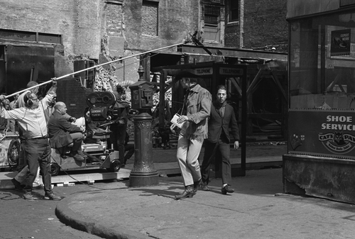 "The famous line ""I'm walkin' here"" was improvised after a real taxi driver drove through the shot. Midnight Cowboy (1969)"
