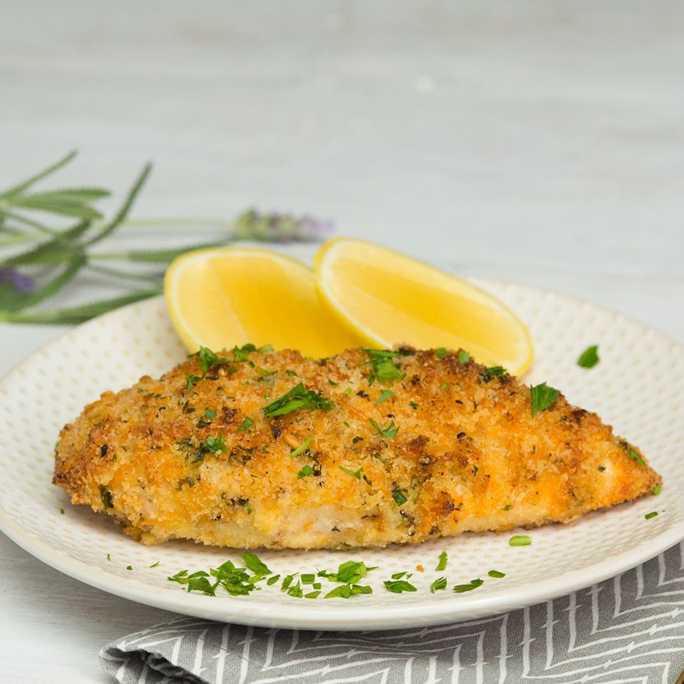 Oven-baked chicken breasts are boring no more when you add panko, cheese and garlic.