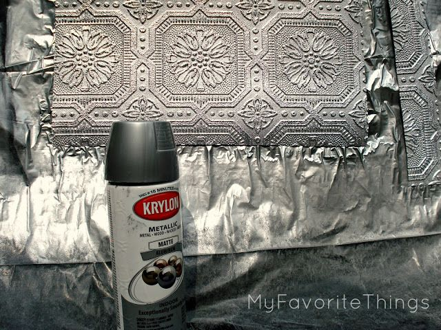 faux tin backsplash using textured wallpaper painted with metallic