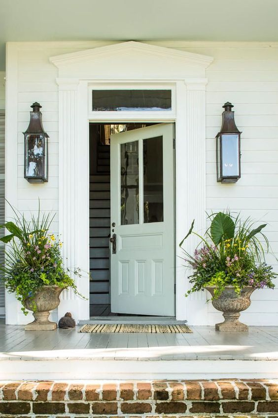 Summertime Flair - Front Door Container Gardens That Will Impress Guests - Southernliving. Every container garden should have a showstopping floral and plant display, and it doesn't get more dramatic than elephant's ear. Surround the oversize leaves with small, colorful bulbs to brighten concrete urns all summer long.