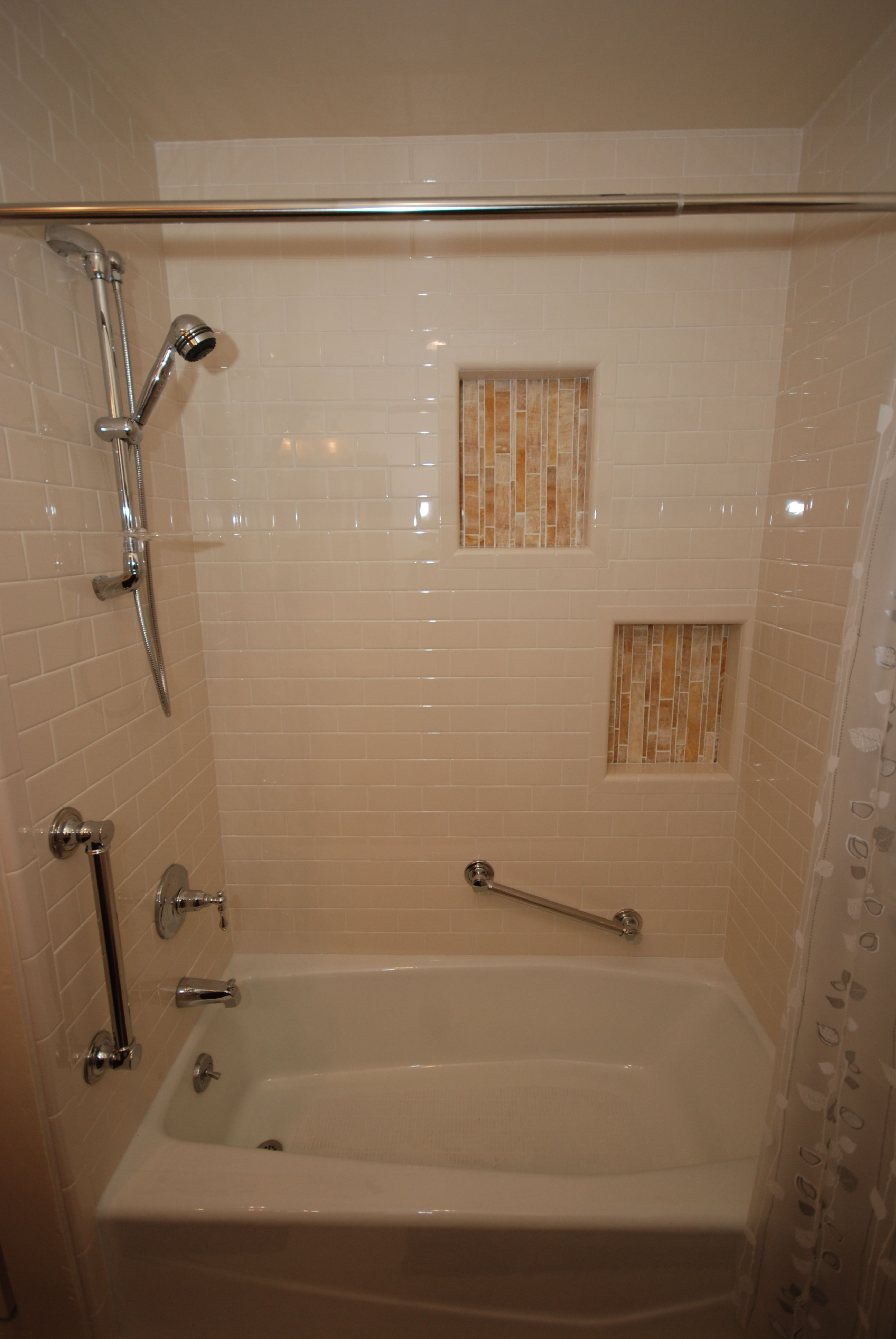 Onyx bathroom tile - Biscuit Subway Tile With Onyx Niches