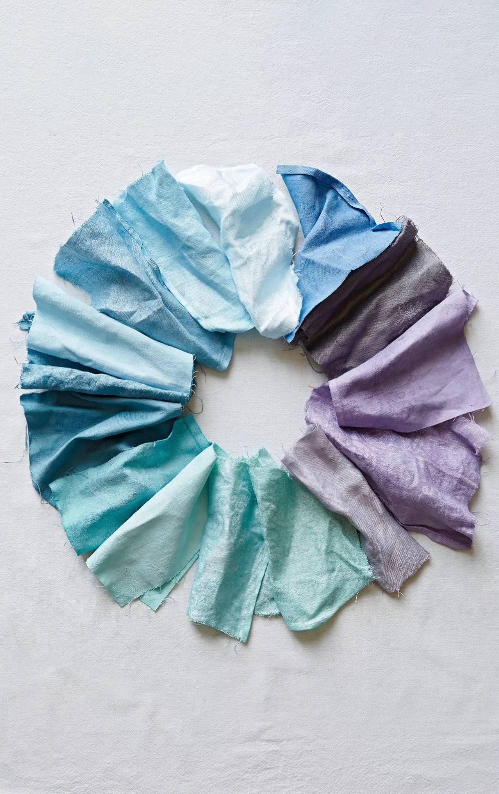dyed cloth napkins arranged in a circle