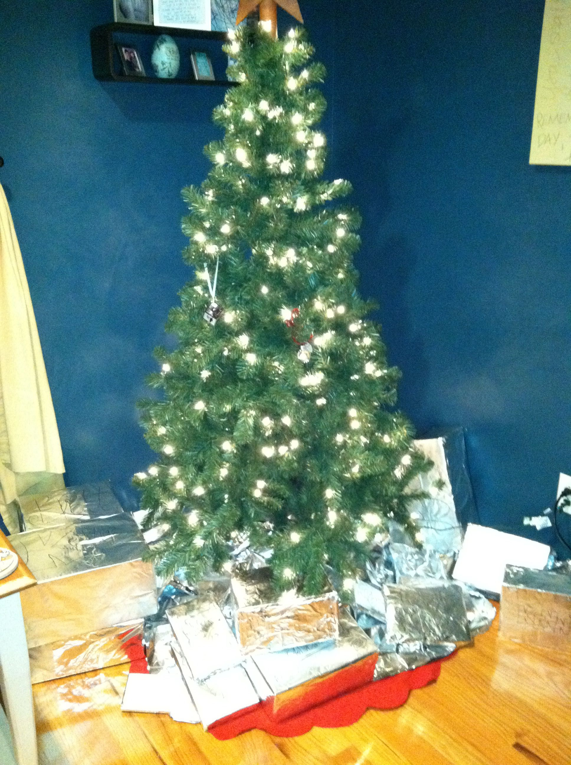 A Cat Proof Christmas Aluminum Foil Tree Skirt And Foil Wrapped