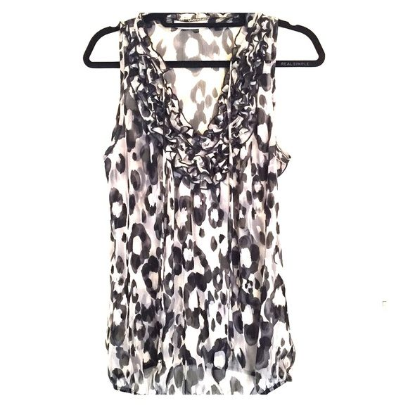 Chiffon blouse with flower pattern Cute sleeveless blouse with flower detail and ruffles around the neck. Elastic around the waist for a snug fit. Worn once or twice. In perfect condition. Charlotte Russe Tops