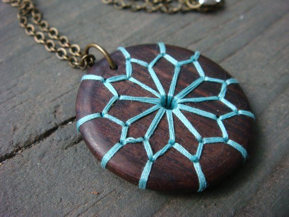 Photo of Items similar to embroidered wood necklace with geometric and floral design on etsy