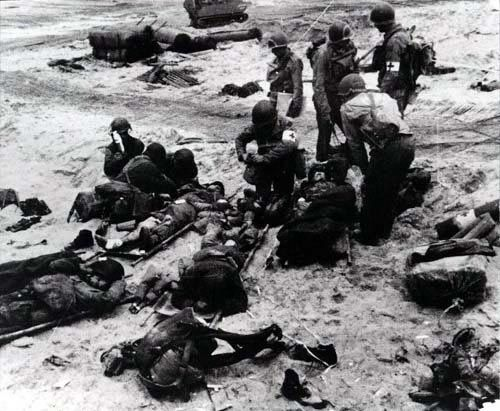 Medics attend to wounded soldiers on Utah Beach in France during the Allied Invasion of Europe on D-Day, June 6, 1944.
