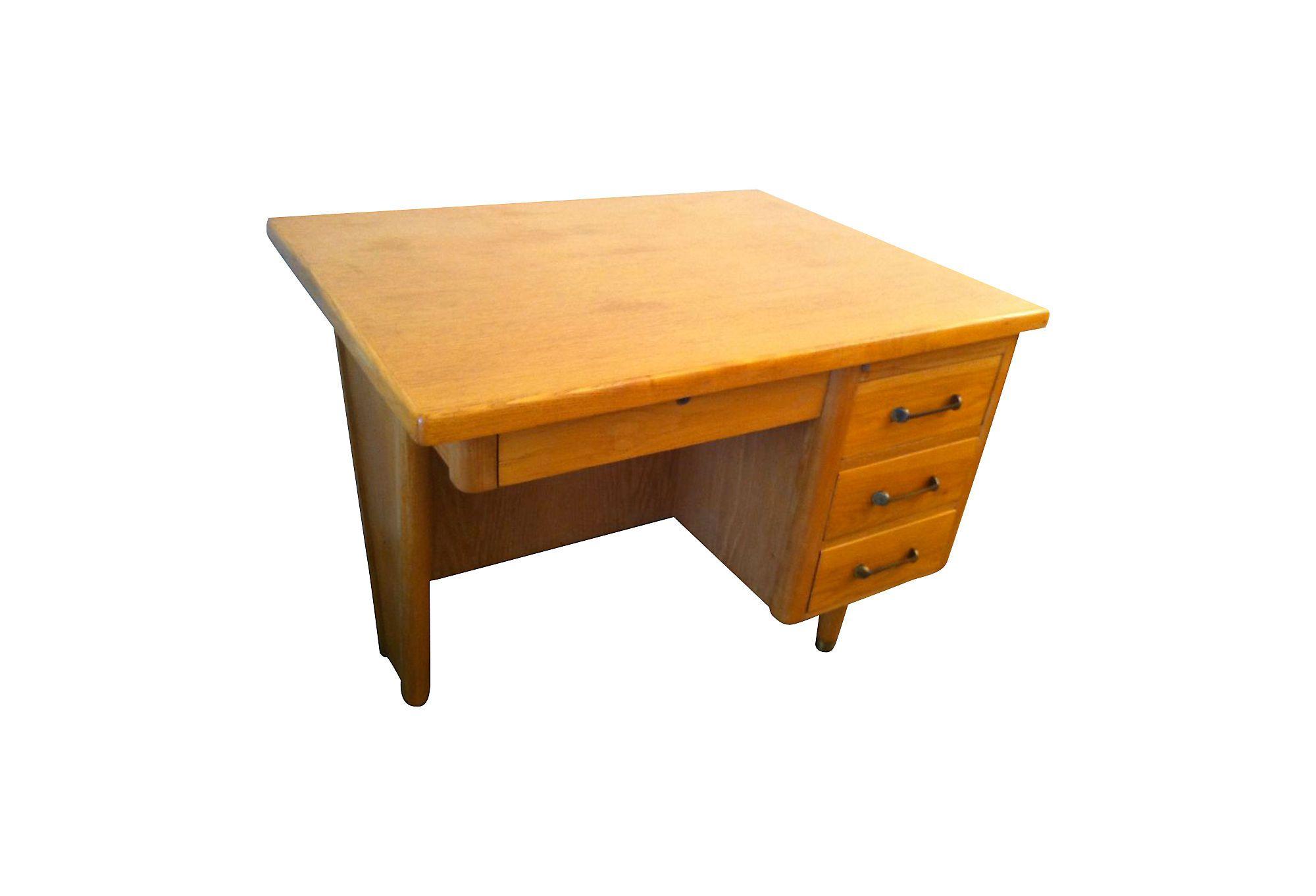 A small light oak art deco herman miller desk with brass