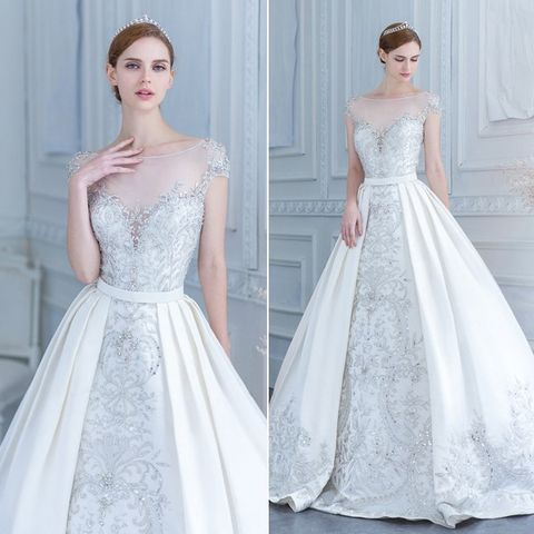 embroidered bead wedding dress with an illusion neckline and a ...